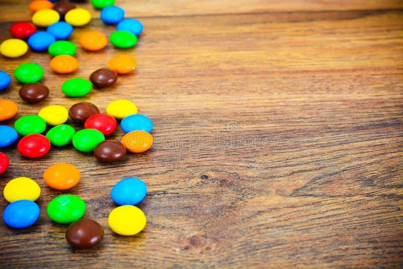 Süße Bonbon-Süßigkeit auf Woody stockfotos