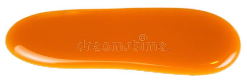 Süße Karamellsoßenstelle oben lokalisiert auf weißem Hintergrundabschluß lizenzfreie stockfotos