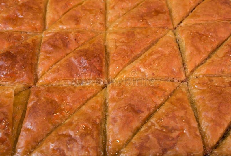 Süßes Baklava mit Honig und Nüssen für Verkauf lizenzfreie stockfotos
