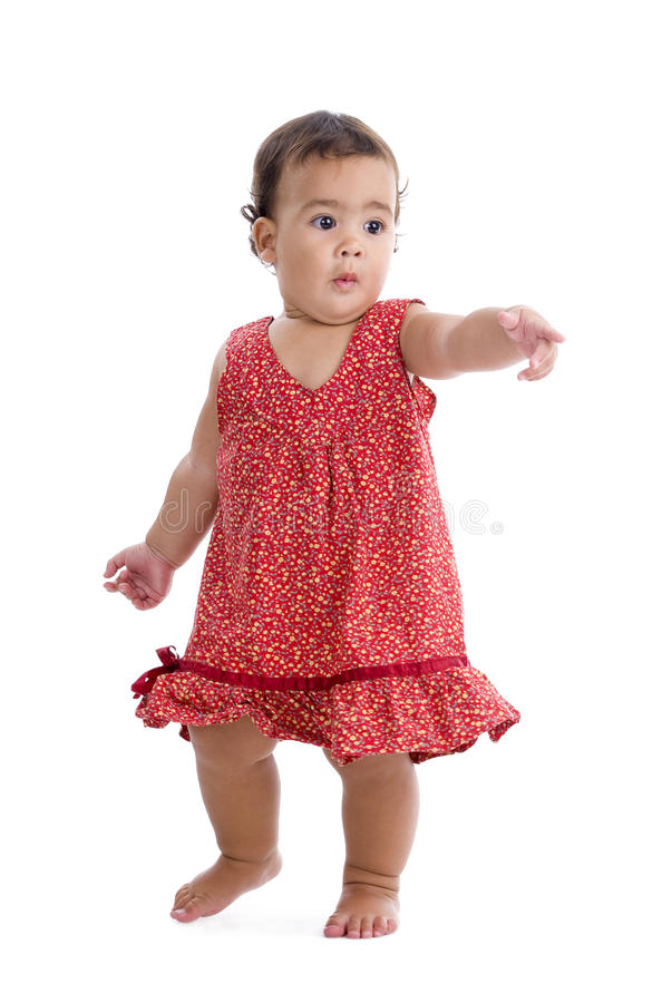 Süßes kleines Mädchen, das auf etwas zeigt stockfoto