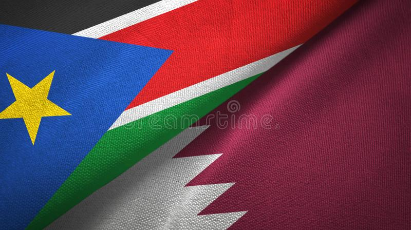 Süd-Sudan- und Katar-zwei Flaggentextilstoff, Gewebebeschaffenheit stockfotografie