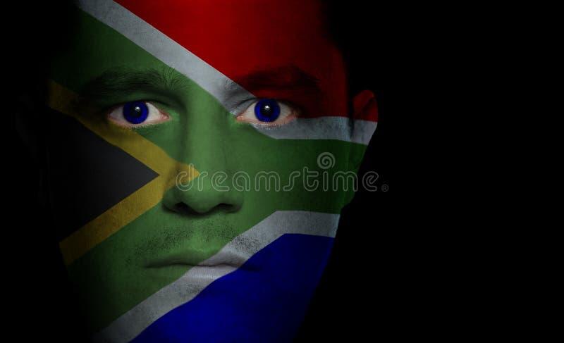 Südafrikanische Markierungsfahne - männliches Gesicht lizenzfreie stockfotografie