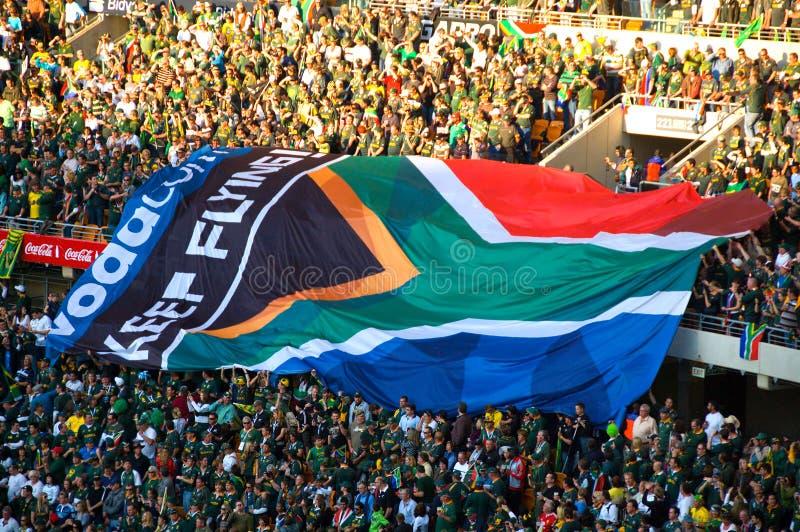Südafrikanische Markierungsfahnen an einem Rugbyspiel lizenzfreie stockfotos