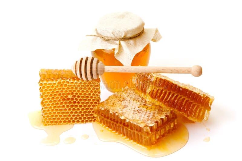 Słój miód z honeycombs obrazy royalty free