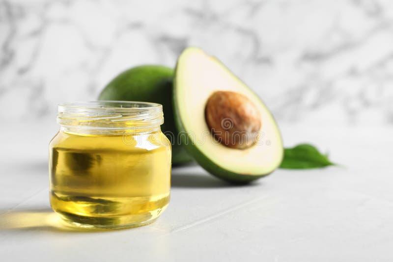 Słój z avocado olejem fotografia royalty free