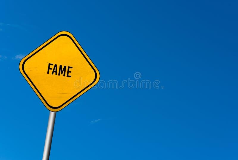 sława - koloru żółtego znak z niebieskim niebem zdjęcia stock