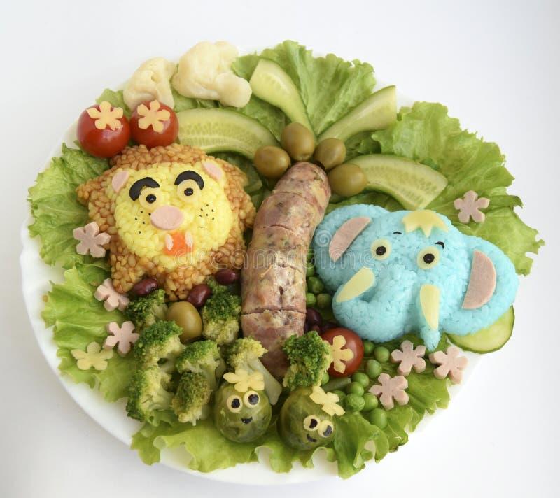 Słoń i lew robią ryż obraz royalty free