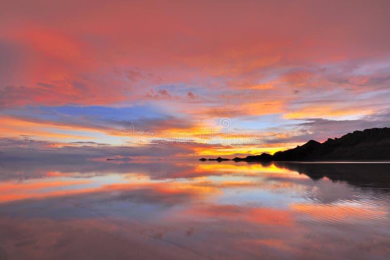 Słońca Uyuni soli ustalony mieszkanie fotografia royalty free