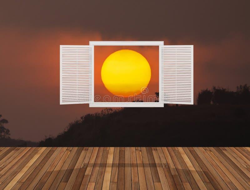 Słońce przy zmierzchem za otwarcia okno fotografia stock