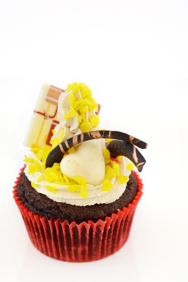 Słodka bułeczka z czekoladową dekoracją zdjęcia stock