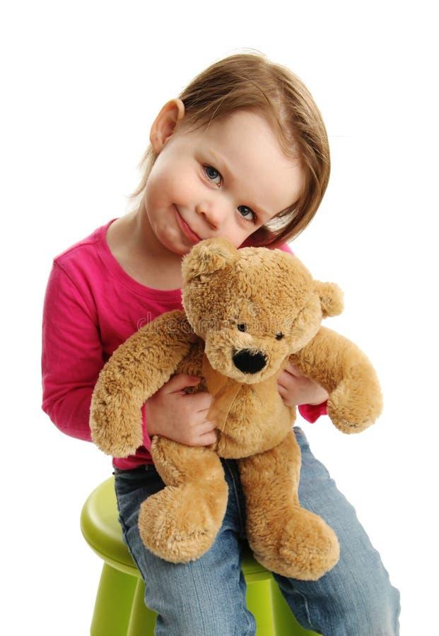Słodka dziewczyna trzyma misia zdjęcie stock