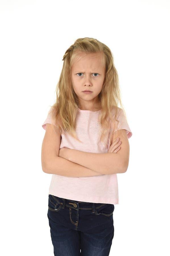 Słodka młoda uczennica z blondynem i składającym ręki gniewnym spęczeniem udaremniającym i nieszczęśliwym fotografia royalty free