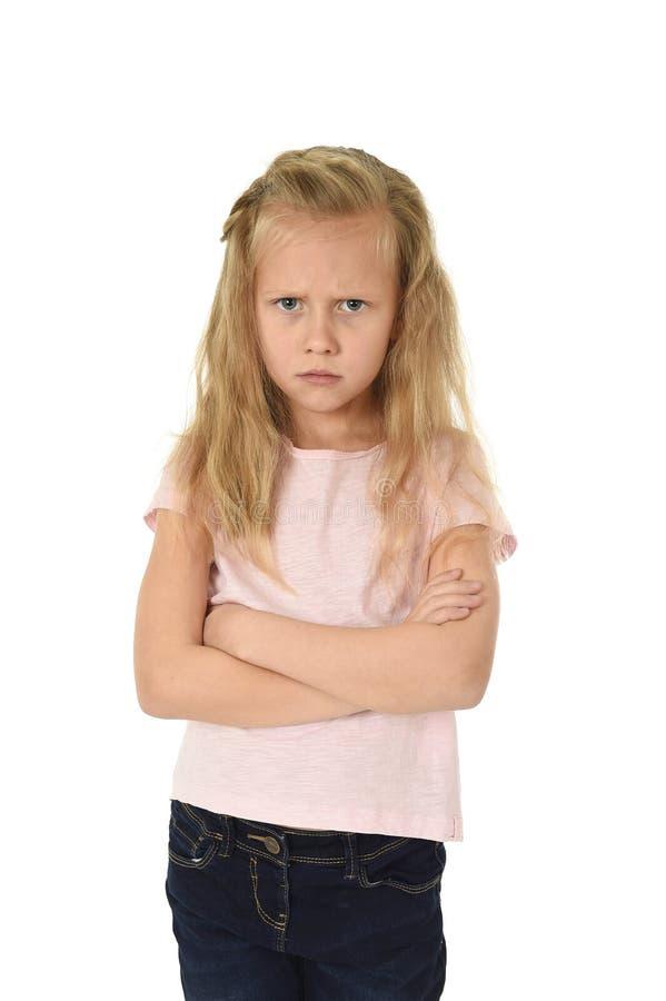 Słodka młoda uczennica z blondynem i składającym ręki gniewnym spęczeniem udaremniającym i nieszczęśliwym obraz stock