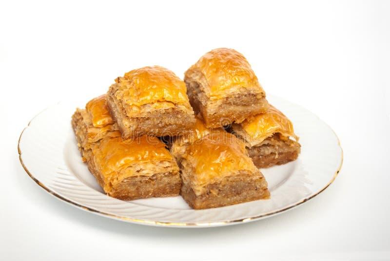 Słodki Baklava na talerzu na białym tle obraz royalty free