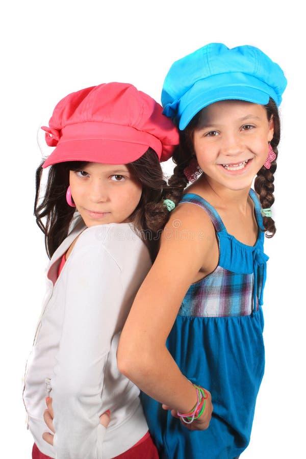 słodkie małe siostry zdjęcia royalty free