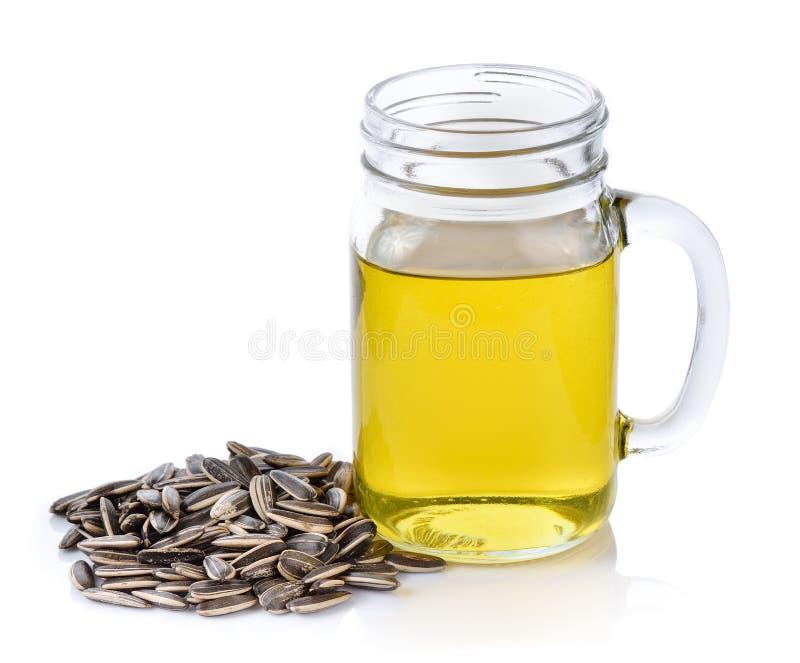 Słonecznikowy nasieniodajny olej na białym tle zdjęcie stock