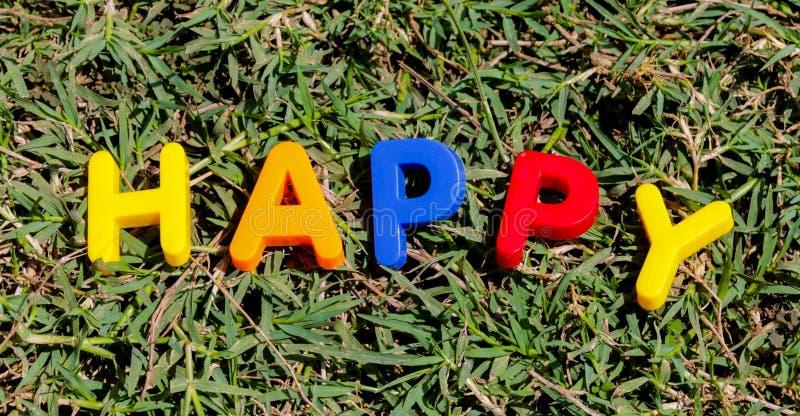 Słowa Szczęśliwy opanowany od listów obrazy royalty free