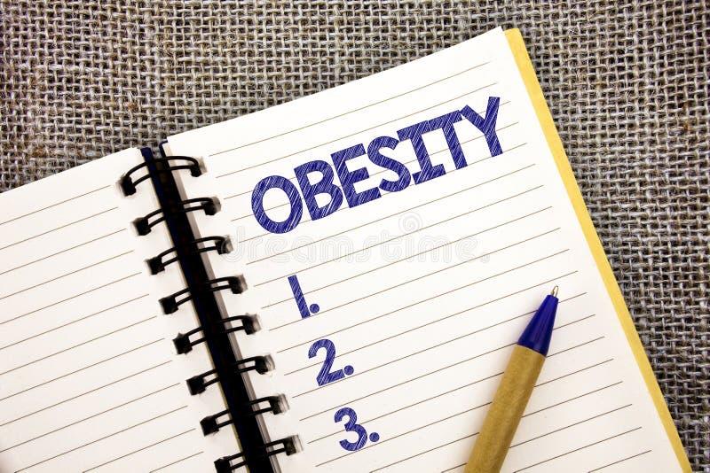 Słowa writing teksta otyłość Biznesowy pojęcie dla stanu medycznego nadmiaru ciała sadło akumulował problemu zdrowotnego Balowego fotografia stock