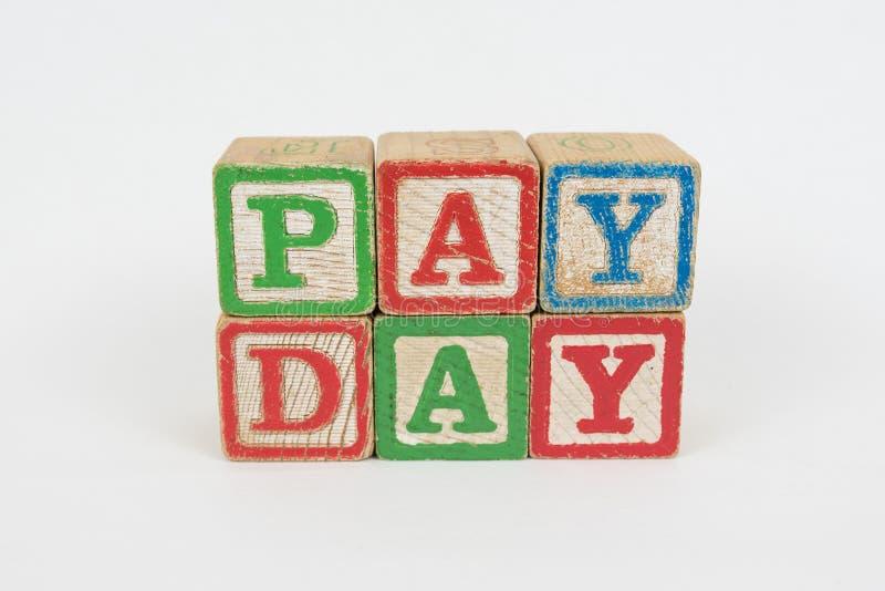 Słowa wynagrodzenia dzień w Drewnianych Children blokach zdjęcia stock