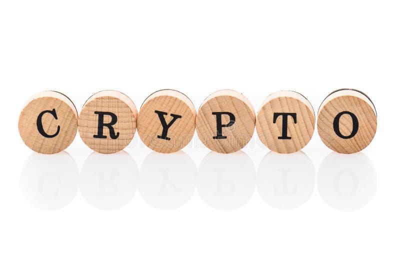 Słowo Crypto od kółkowych drewnianych płytek z listów dziećmi bawi się zdjęcie stock