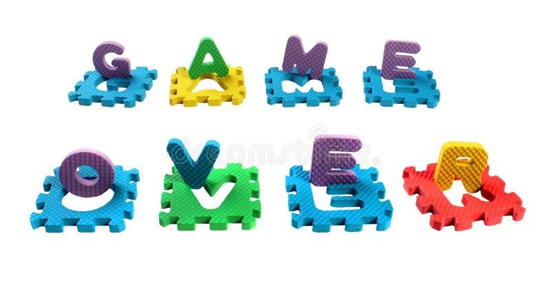 Słowo gra Nad opanowanym cięcia out listy zabawkarska plastikowa abecadło łamigłówka, odosobneni na białym tle obraz royalty free