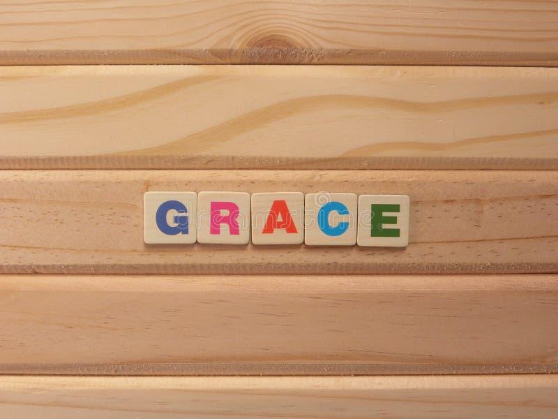 Słowo Grace na drewnie obraz stock