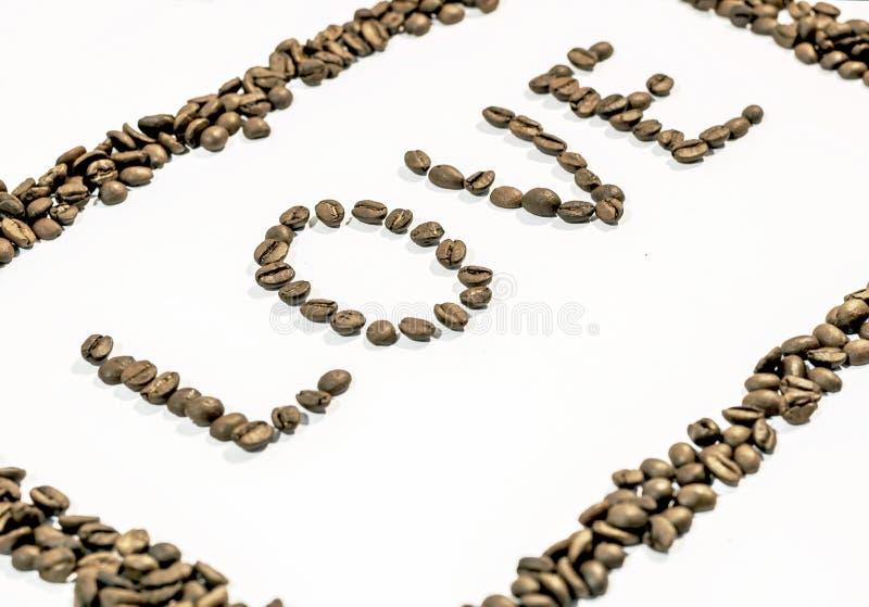 Słowo miłość pisać od strony z kawowymi fasolami i ramą robić kawa zdjęcie royalty free