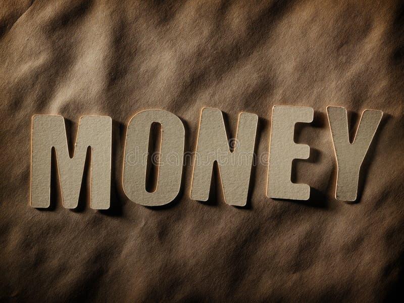 Słowo pieniądze na papierowym tle fotografia royalty free