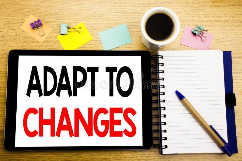 Słowo, pisze Adaptuje zmiany Biznesowy pojęcie dla adaptaci Nowej przyszłości Pisać na pastylka laptopie, drewniany tło z kleisty obraz royalty free