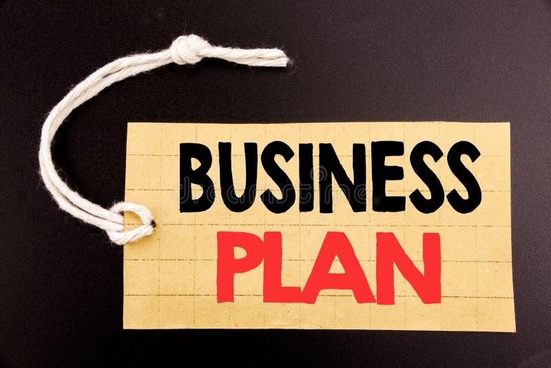 Słowo, pisze planie biznesowym Biznesowy pojęcie dla online sprzedaży misi lub wzrok pisać na metka papierze na czarnych rocznikó zdjęcia stock