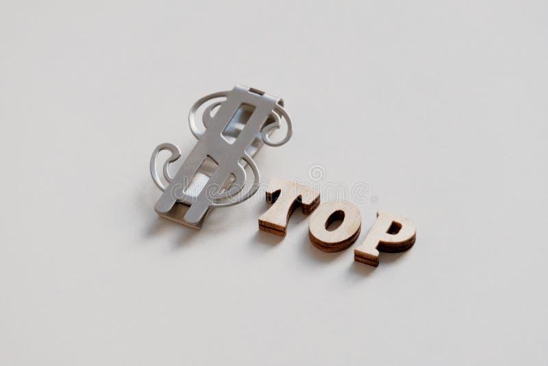 Słowo przerwa zrobi drewniani listy i srebny dolarowy znak na białym tle Pieniądze wierzchołek przepływ gotówki fotografia stock