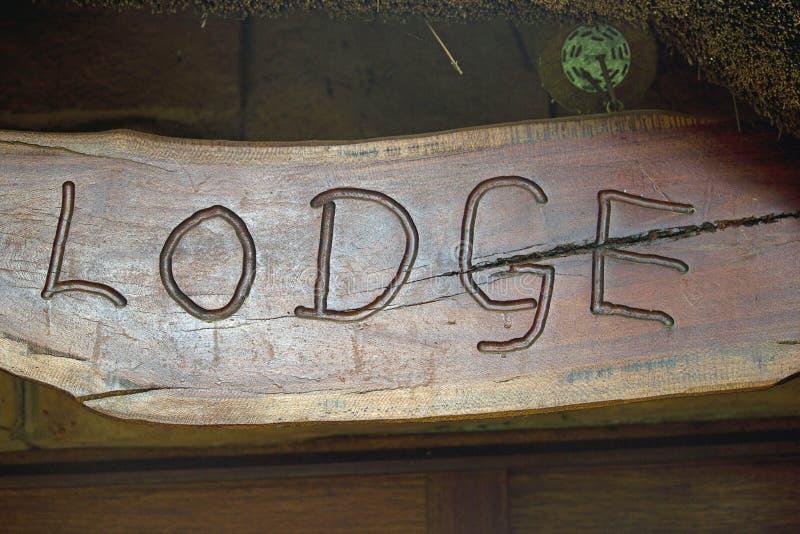 Słowo stróżówka grawerująca w drewnie obrazy stock
