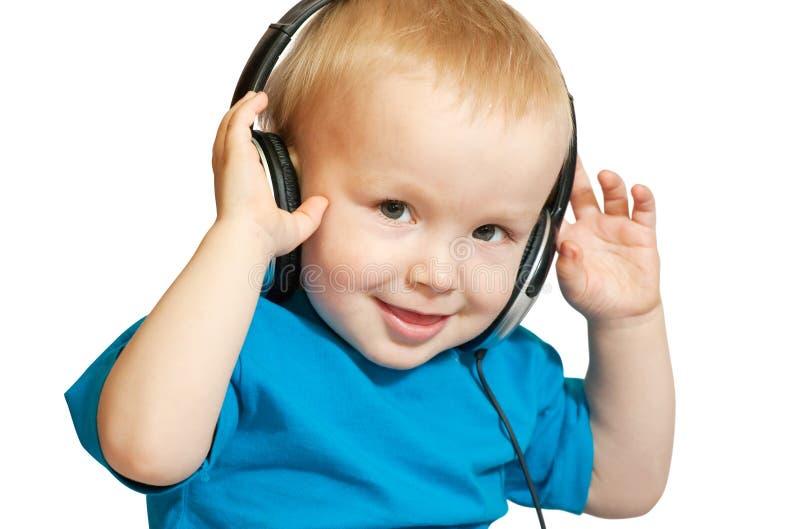 słuchająca chłopiec muzyka zdjęcie stock