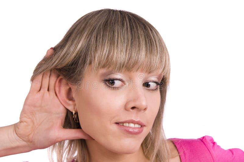 słuchająca plotki kobieta zdjęcie royalty free