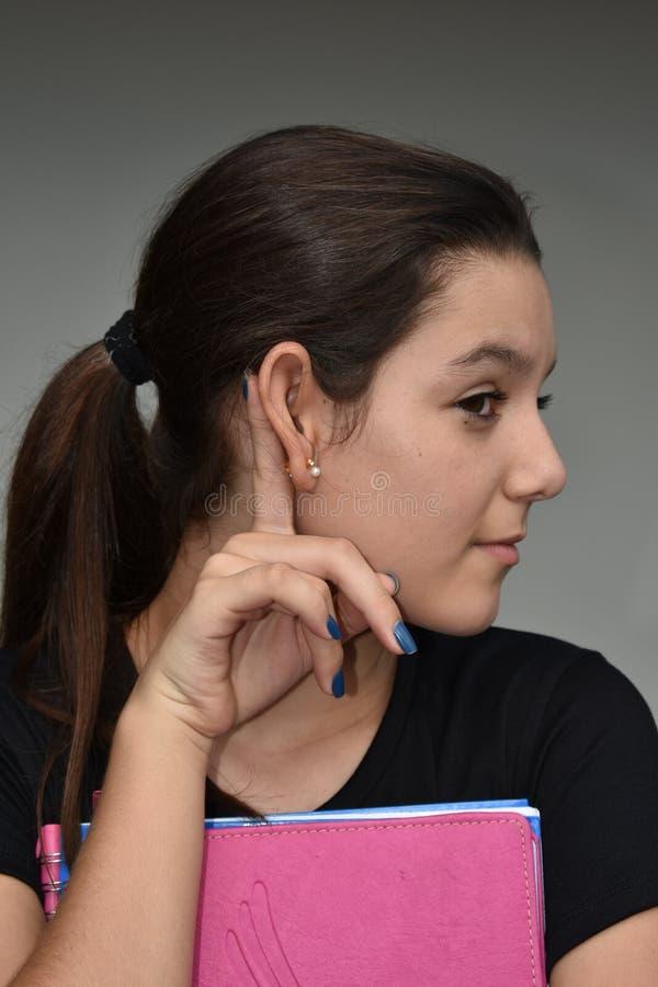 Słuchający dziewczyna uczeń zdjęcie royalty free