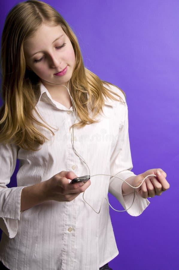 słuchający muzyczny nastolatek zdjęcia stock