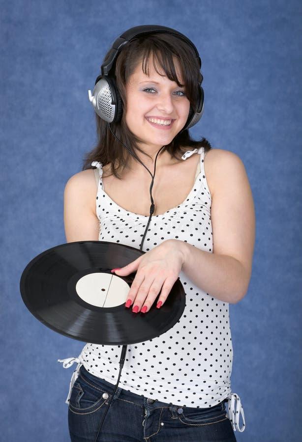 słuchawek kobiety potomstwa zdjęcie royalty free