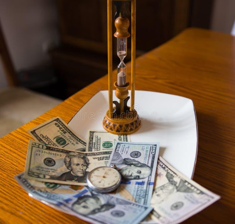 Słuzyć czas i pieniądze na drymbie zdjęcia royalty free