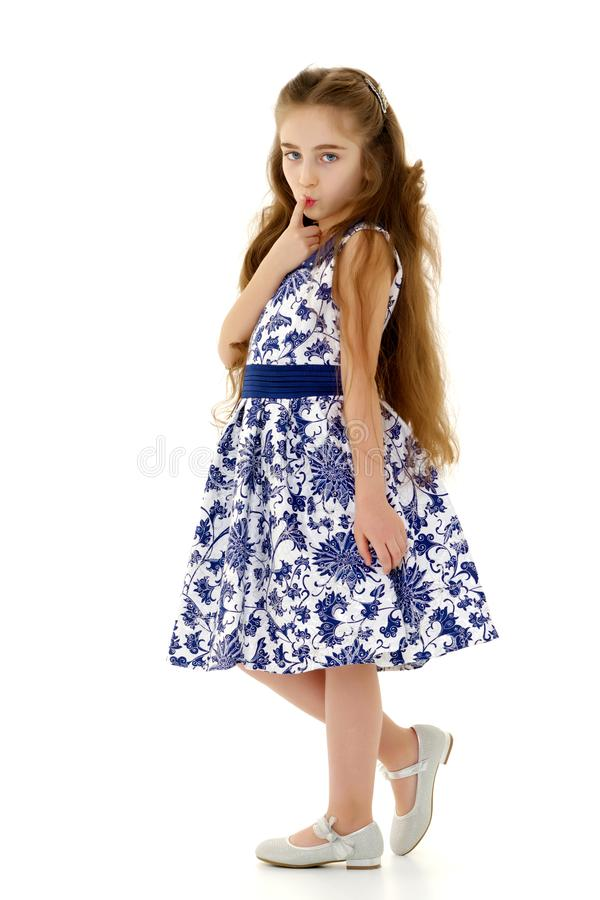 Маленькая девочка думает стоковое изображение
