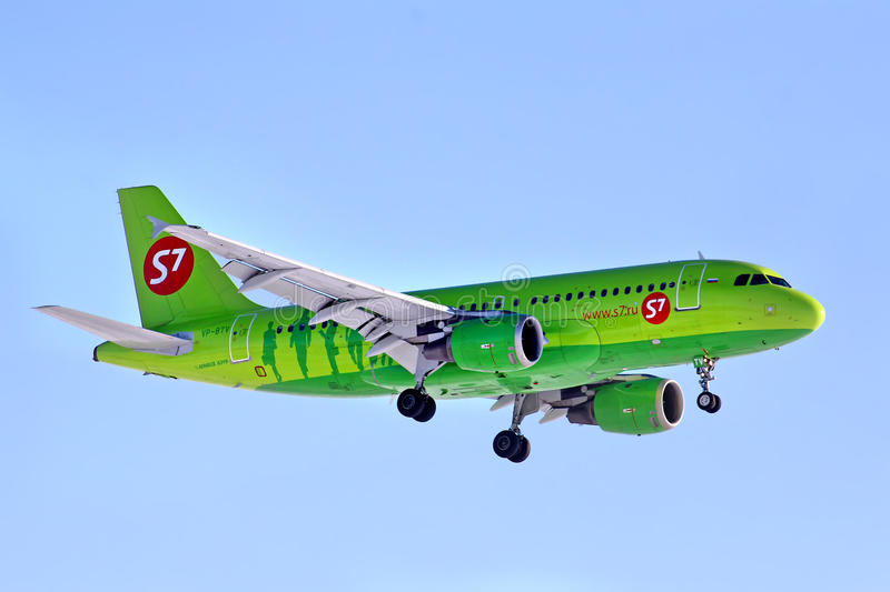 S7 Airlines Airbus A319. NOVYY URENGOY, RUSSIA - MARCH 30, 2014: S7 Airlines Airbus A319 arrives at the Novyy Urengoy International Airport royalty free stock image