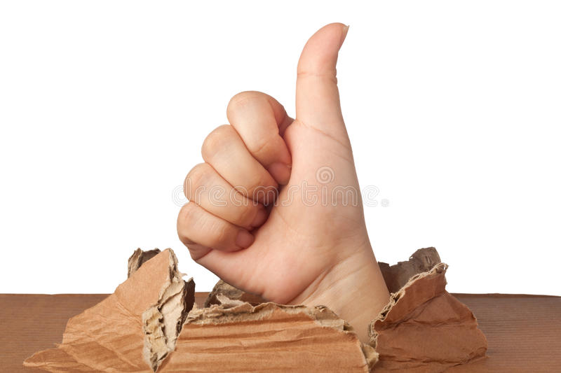It's all good. Hand out of a hole showing a good sign royalty free stock image