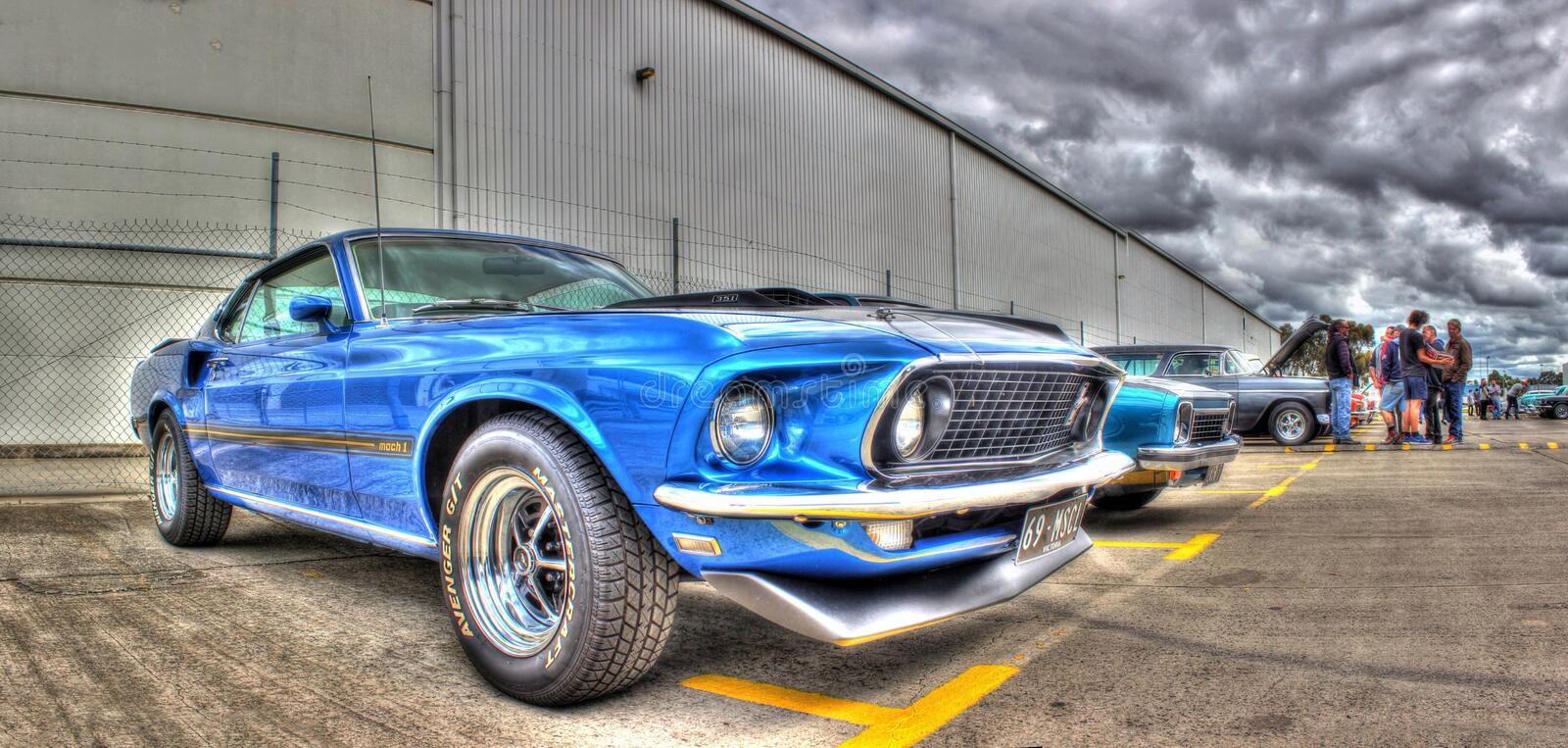 1960s American Ford Mustang. 1969 blue Ford Mustang Mach 1 on display at car show in Melbourne, Australia. The Ford Mustang is considered the first of the stock image