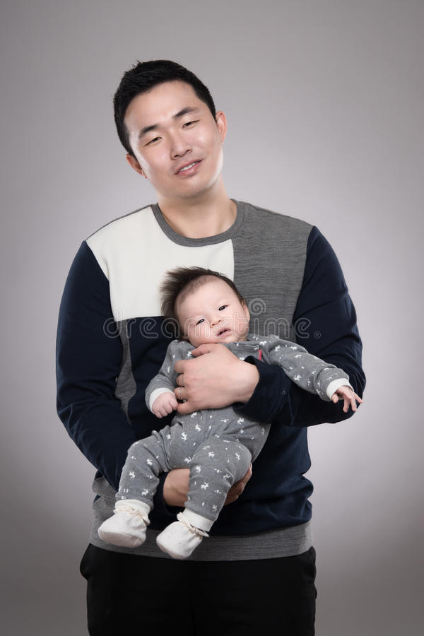 30s Asian man and son with studio portrait - isolated