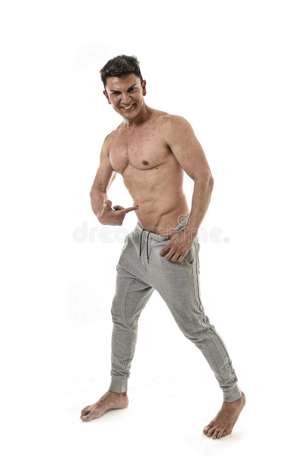 40s attractive hispanic sport man and bodybuilder posing corporate pointing his abs in naked torso stock photos