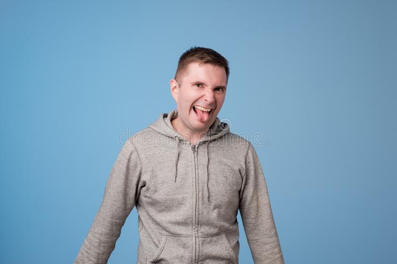 It`s so awful. Studio portrait of young european man with disgusted expression repulsing something royalty free stock photo