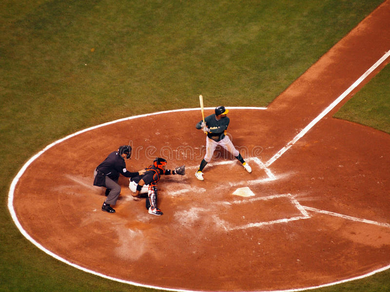 A's batter stands in batters box with catcher royalty free stock photography