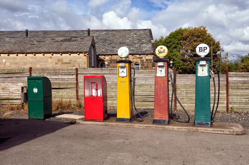 1930s Petrol Pumps, Dudley, West Midlands. 1930s British petrol pumps, engine oil dispenser and motor oil storage cabinet outside Broome`s Garage at the Black royalty free stock photography