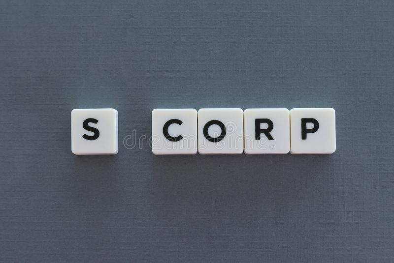 S Corp word made of square letter word on grey background. Corporation corporate company business entrepreneur financial s-corp pen idea concept presentation stock image
