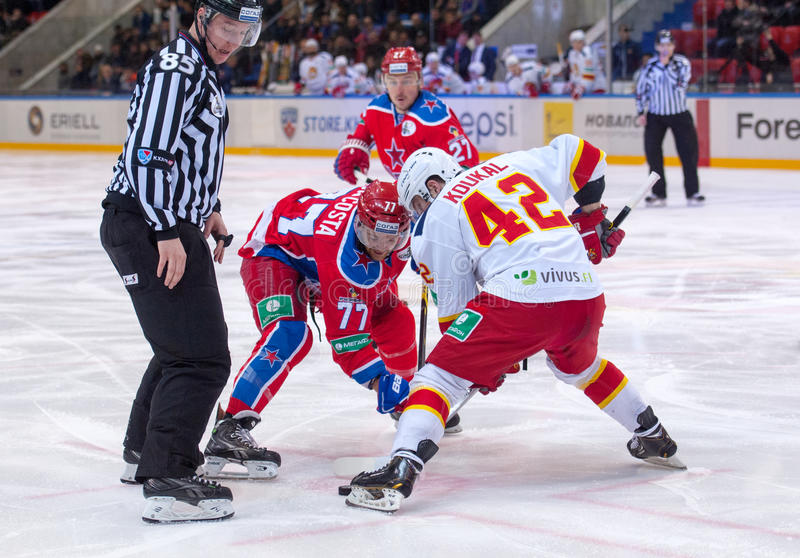 S. Da Kosta (77) vs P. Koukal (42). MOSCOW - MARCH 12: S. Da Kosta (77) vs P. Koukal (42) on faceoff on hockey game Yokerit vs CSKA on Russia KHL championship on stock images