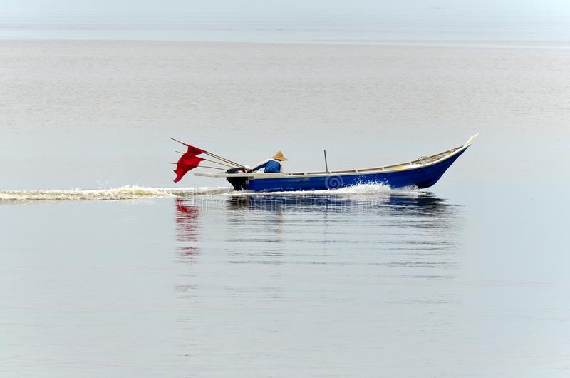 ` S de pêcheur allant à la mer pêcher des poissons image stock